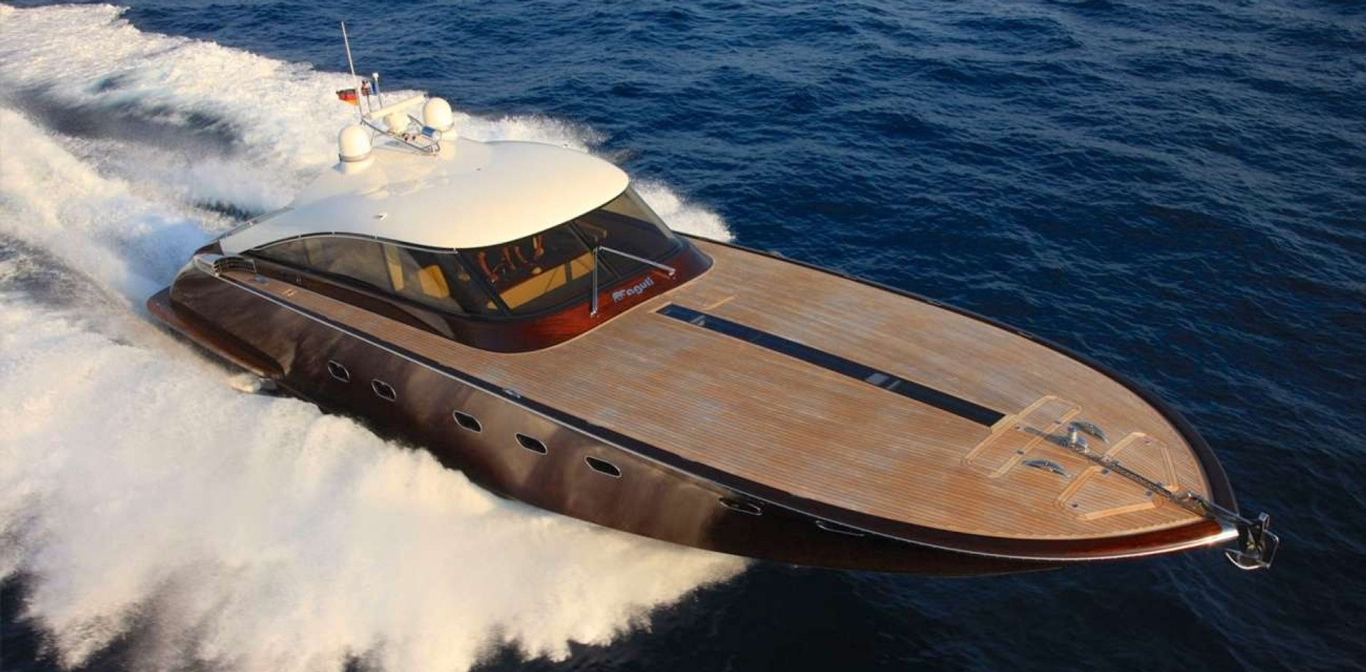 A wooden motor yacht Riva style
